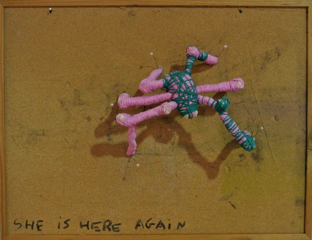 SHE IS HERE AGAIN, corkboard, textile, thread, pins, 64x49cm